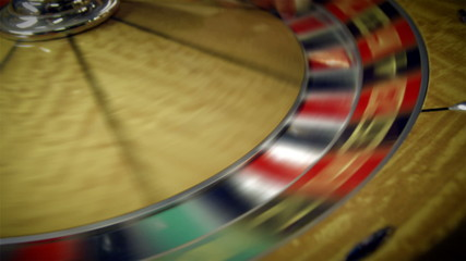 Close up of a roulette table turning.