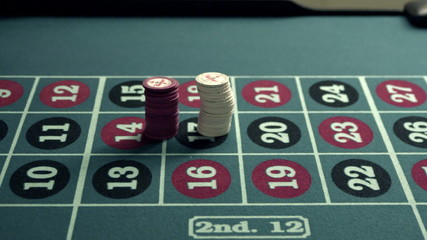 Chips being piled onto a roulette table.