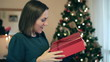 Woman shaking present to determine what it contains