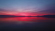 Stock Video Footage of the colorful sky reflected in the Sea of Galilee in Israel.