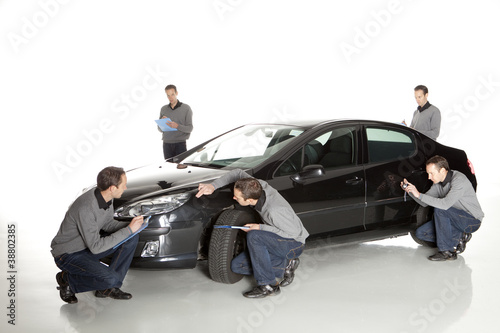 Insurance agent looking at car