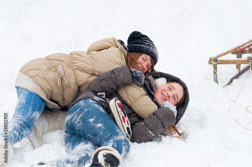Beautiful teenage girls having fun in the snow