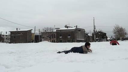 children paly soccer in the snow