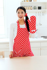 Beautiful apron woman in the kitchen