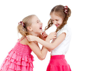 Two girls fighting isolated over  white background