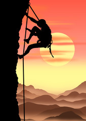climber on sunset background.