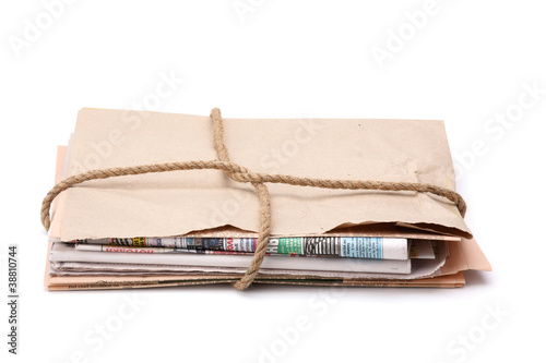 Newspaper stack, isolated on white background