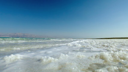 Stock Video Footage of Dead Sea waves on the salty shore in Israel.