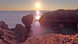 Stock Video Footage of the rocky Dor Beach coast at sunset in Israel.