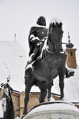 The snow covered statue of Mathias King, Cluj Napoca, Romania