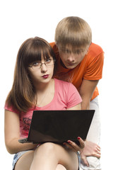 The girl and the young men behind the computer