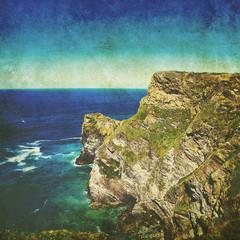 old photo of ocean cliffs