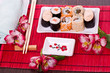 sushi rolls on the white plate with flowers