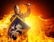 Medieval knight in attack position on fire background.