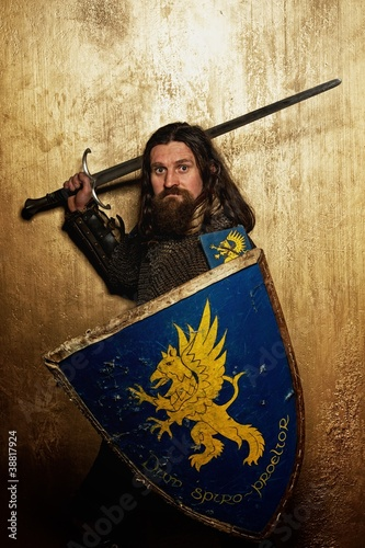 Medieval knight on golden background.