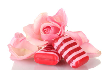 Two soap and pink rose isolated on white