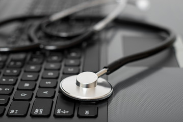 Computer with stethoscope on it