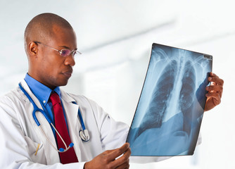 Black doctor watching x-ray