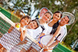 Tennis family by the net