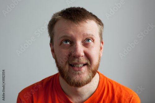 Young man in an orange shirt