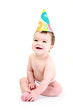 Laughing baby wearing party hat - celebration