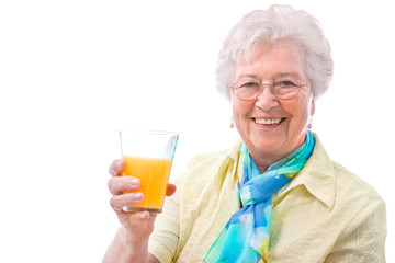 senior woman with a glass of juice