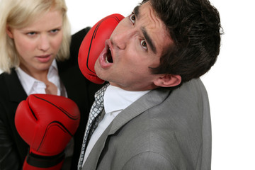 blonde businesswoman boxing a colleague