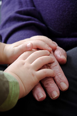 Hands of the old woman and child