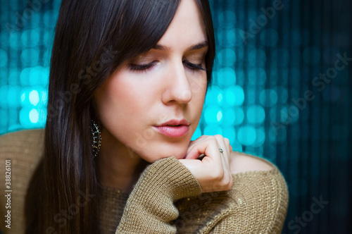 Girl posing in front of glowing background