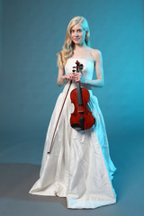 Beautiful young woman with a violin.