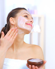 Beautiful Woman Applying Natural Homemade Facial Mask
