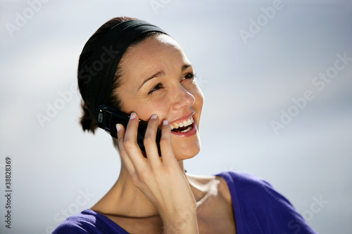 Brunette making a phone call outdoors
