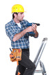 Tradesman using an electric screwdriver