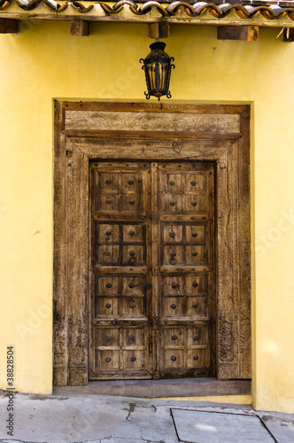 Old wooden door with metal details