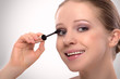 beauty girl paints the eyelashes makeup mascara