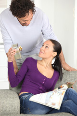 Man offering gift to his wife
