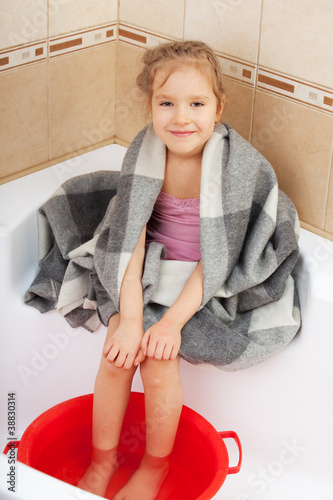 Girl floating feet in hot water