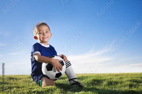 Young hispanic soccer player smiling