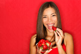 Woman eating strawberries - 38830961