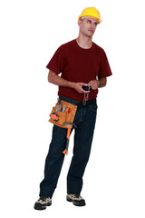 A very annoyed tradesman holding a chalk line
