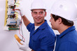Electrical safety inspectors verifying central fuse box