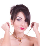 Beautiful young woman with golden jewelry