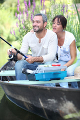 a couple fishing on a boat