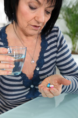 Mature woman taking drugs