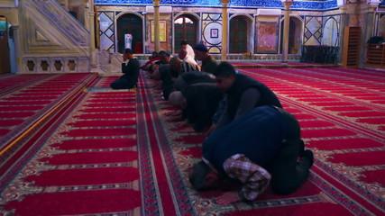 Stock Video Footage of kneeling muslim men filmed in Israel at 4k with Red.