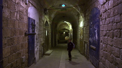 Stock Video Footage of a boy playing soccer in an Akko alley filmed in Israel at 4k with Red.