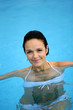 Brunette in swimming pool