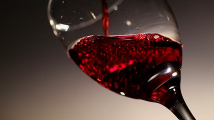 Glass glass with bright wine red flowing in it