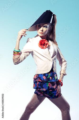 Young woman wearing futuristic headwear