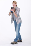 Woman holding cordless drill